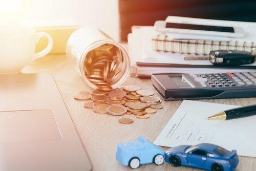 Car insurance concept:Car claim form with car toy crash on desk